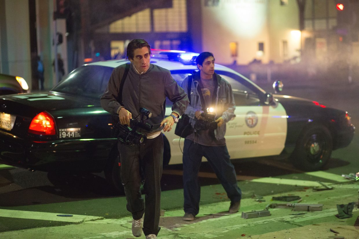 """Lou Bloom (Jake Gyllenhaal) and his assistant, Rick (Riz Ahmed), head out to find some Los Angeles crime action in """"Nightcrawler."""" The movie is about a man who makes his living recording video of violent crimes and selling footage to television news."""