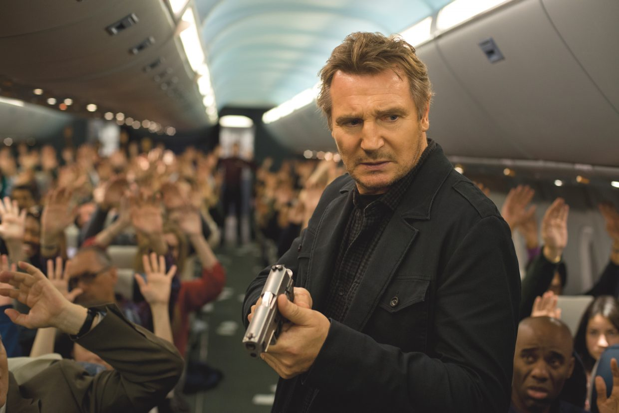 """Bill Marks (Liam Neeson) searches for a possible killer in """"Non-Stop."""" The movie is about an air marshal who must discover who is sending him deadly threats in the middle of a transatlantic flight."""
