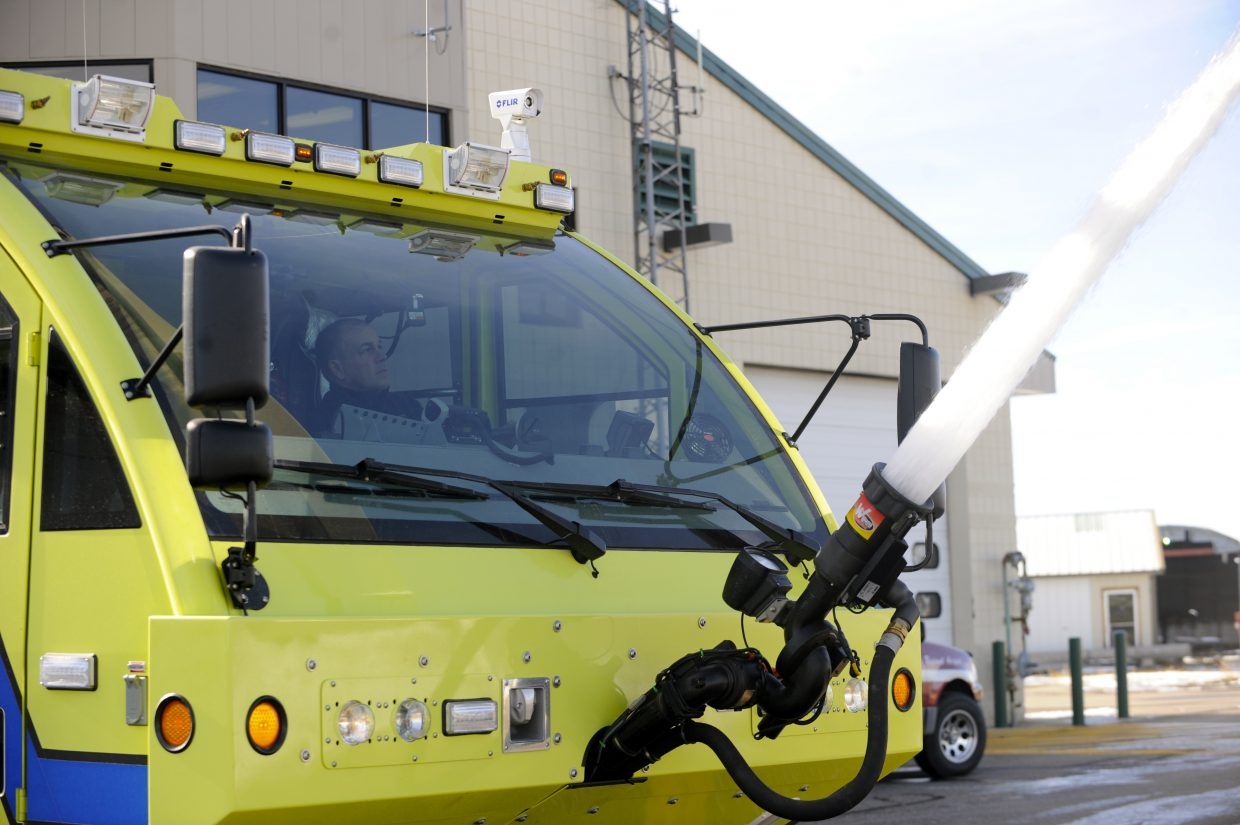 Yampa Valley Regional Airport fire Capt. Shawn Zwak tests the water on the airport's fire truck. The airport is gearing up for commercial flights Dec. 19.