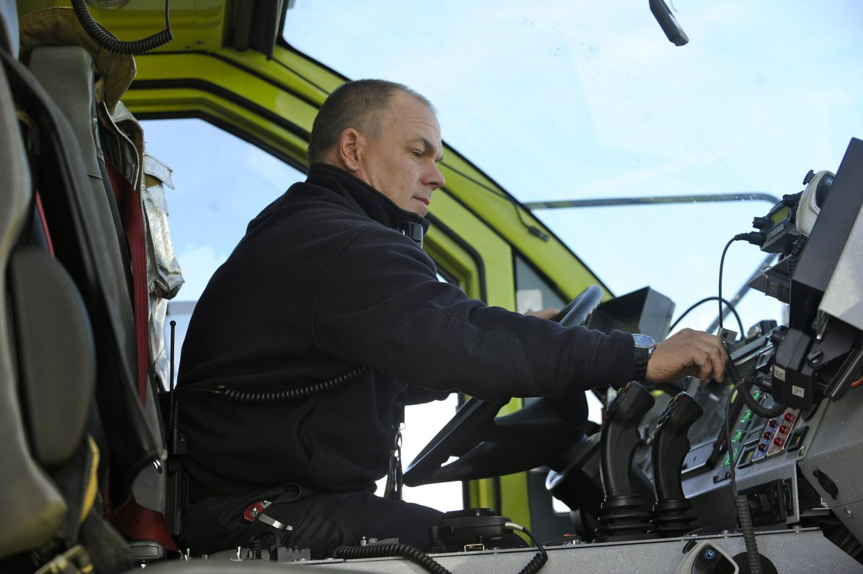 Yampa Valley Regional Airport Fire Capt. Shawn Zwak checks the gauges in a fire truck. Crews are getting ready for commercial flights to begin Dec. 19.