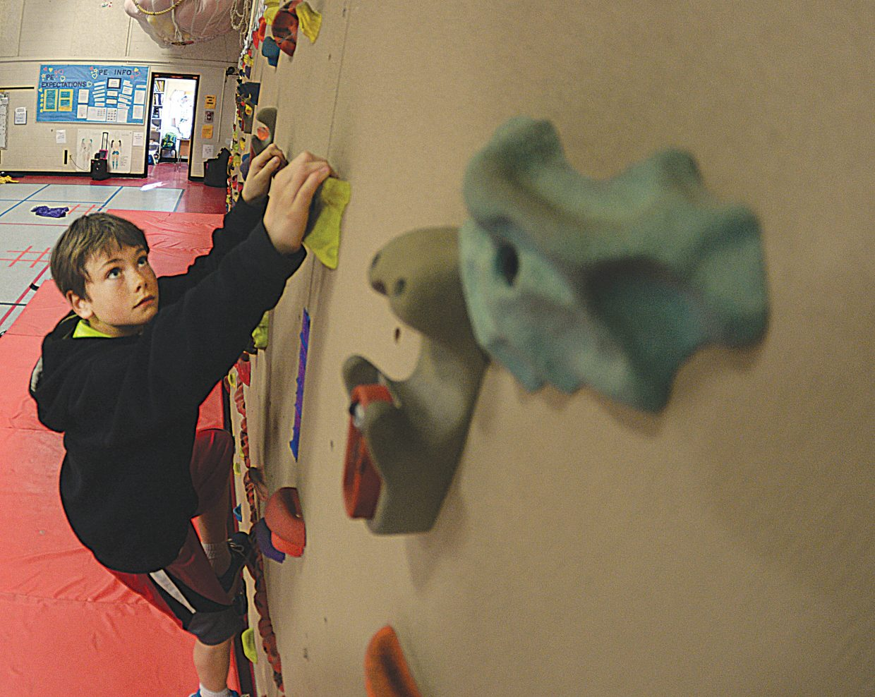 Fifth-grader Orion Gibbs uses the climbing wall at Strawberry Park Elementary earlier this month. The Education Fund contributed $5,000 each toward climbing walls at each district elementary school.