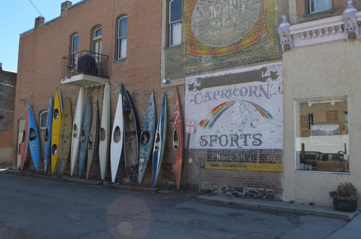Showing the artistic character of Salida, these kayaks are along the wall near Stephen Smalzel's gallery.