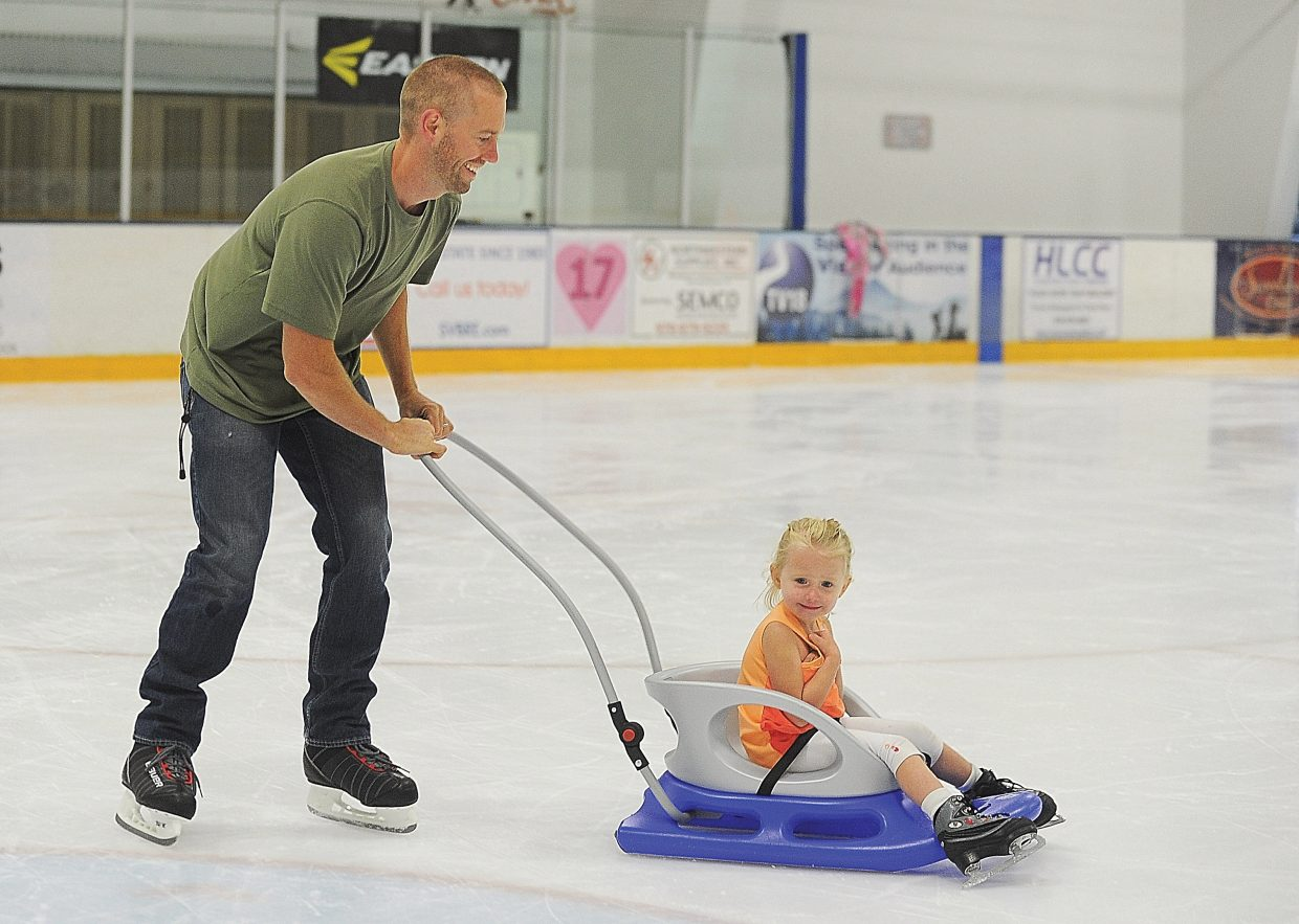 Will Hall gives Evolee Hall a push around the ice at the Howelsen Hill Ice Arena during a family vacation to Steamboat Springs in2014. The staff at the Howelsen Hill Ice Arena knows that the local ice arena is a draw for tourist, and is constantly working to make sure they offer open skating session for visitors and locals. The staff believes that an added sheet of ice could make open skating sessions more consistent, and draw more people to come to the arena to skate.