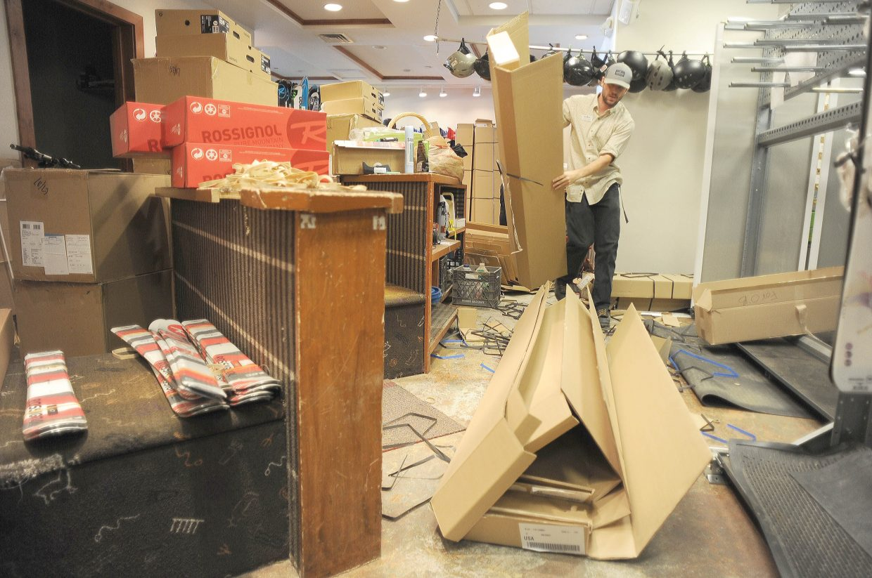 Michael Rabbit breaks down boxes in the back room of a ski shop owned by Steamboat Ski Area.