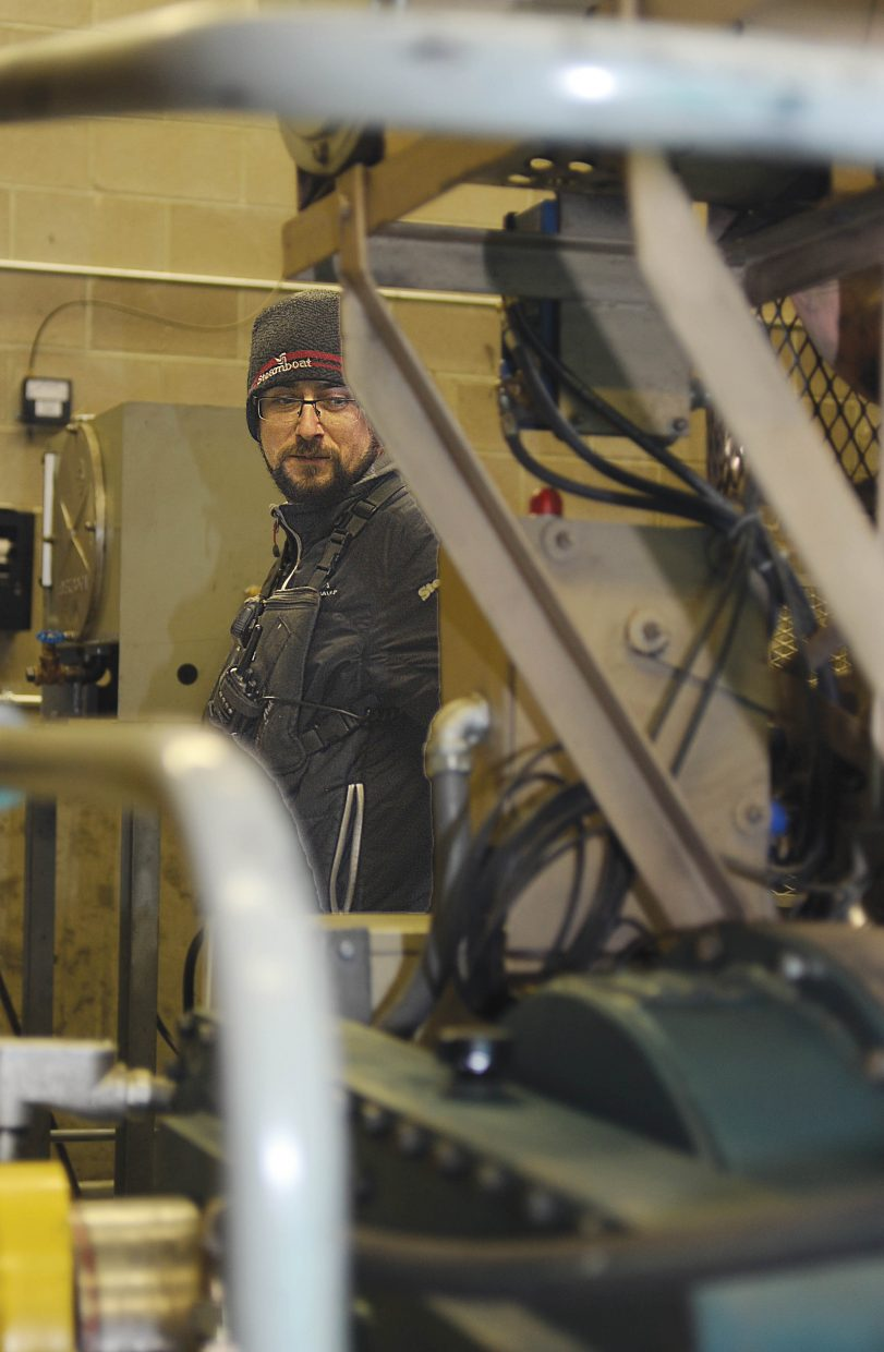 Lee Lapine checks out the equipment located inside the gondola building at Steamboat Ski Area.