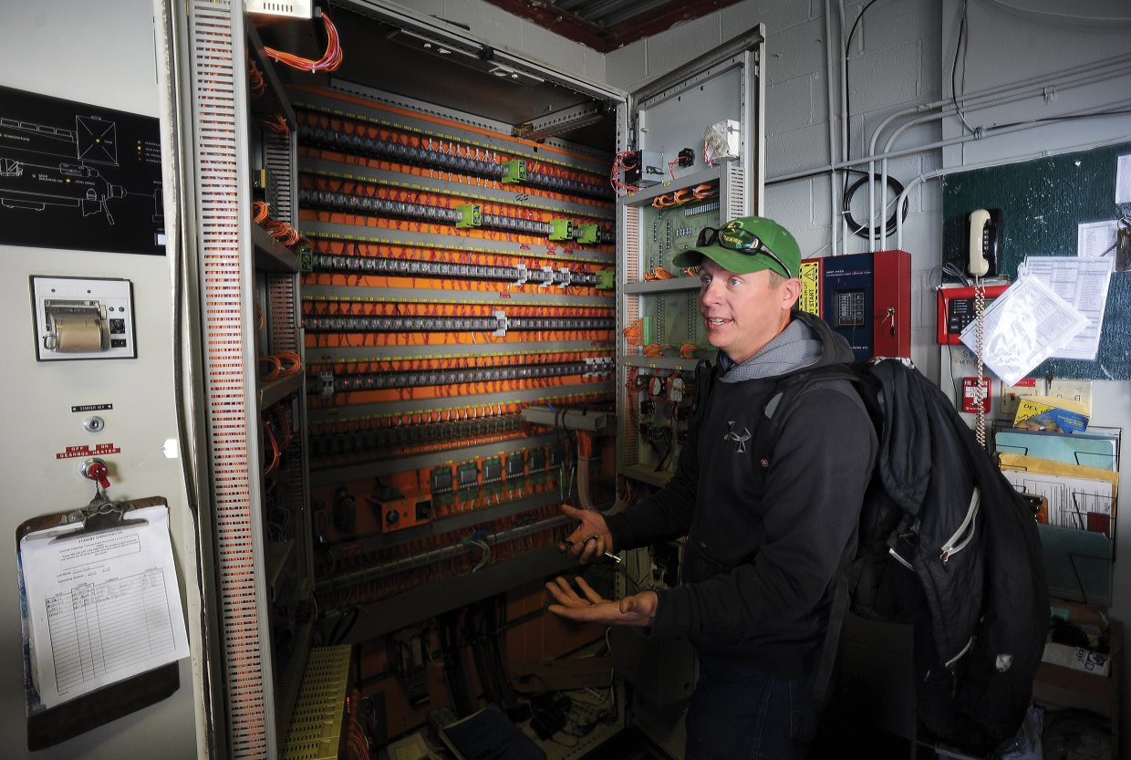 Kurt Castor talks about the number of switches found in the gondola's main control box. Castor is in charge of the crews that maintain the lift system at Steamboat Ski Area.