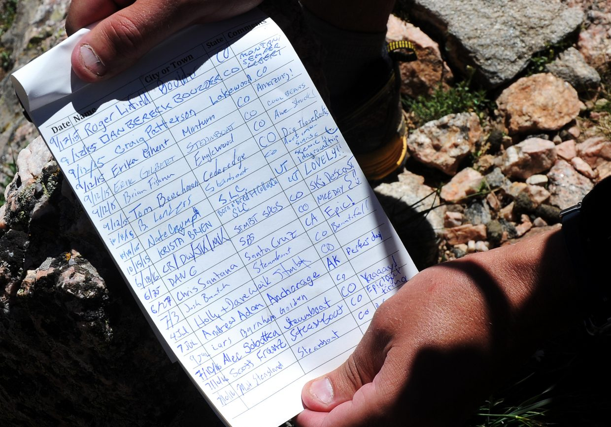 Signing the trail register at the summit of Mount Zirkel is a worthy accomplishment.