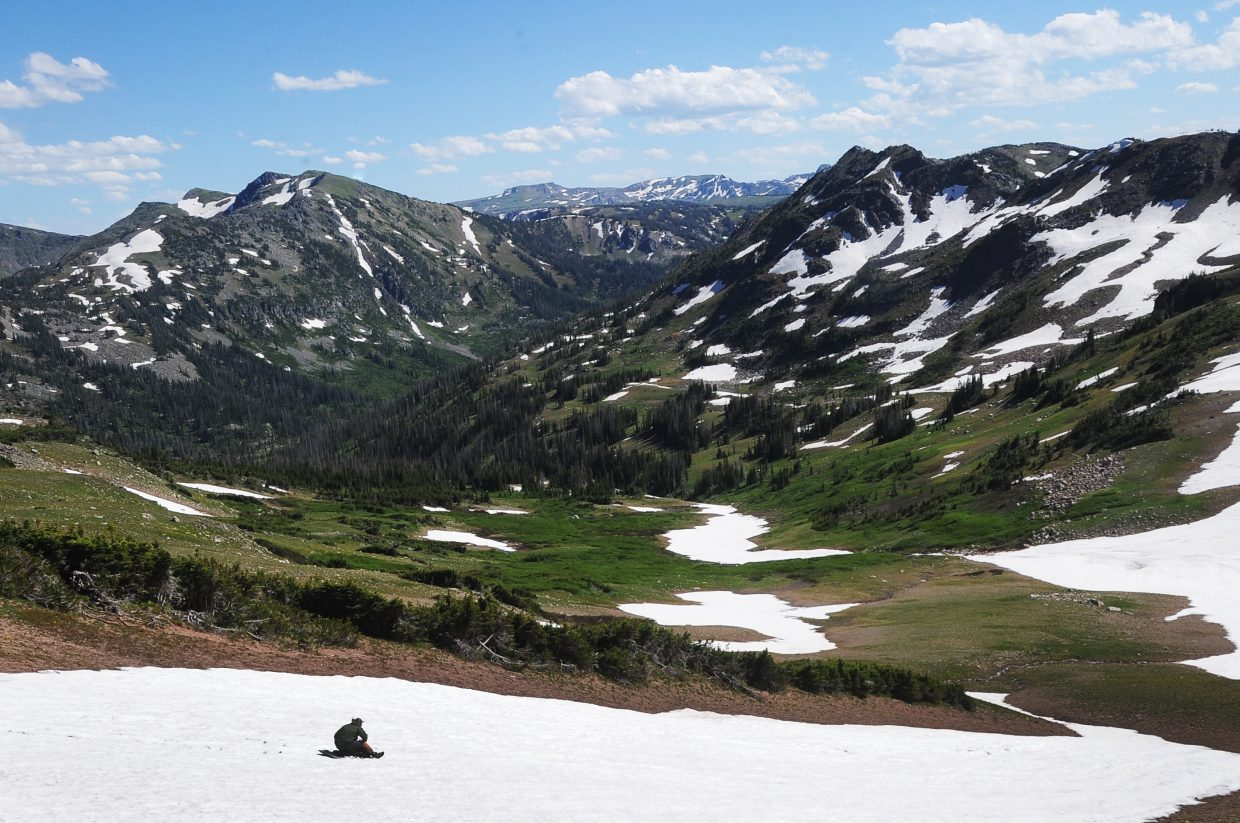 Alec Sobotka attempts to sled down Red Dirt Pass in the Zirkel Wilderness.