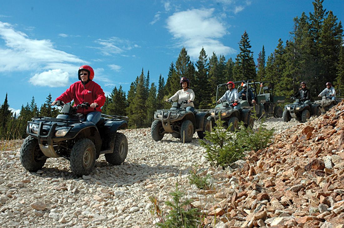 This group of OHV riders, which are not riding on county roads, wisely chose to wear helmets.