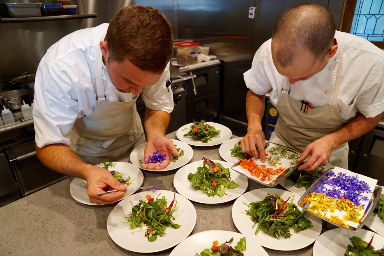 Patrick Ayres works with Brian Sites plating a course during a lunch seminar at  the Cloverdale Restaurant. Cloverdale will close it's doors Oct. 6.