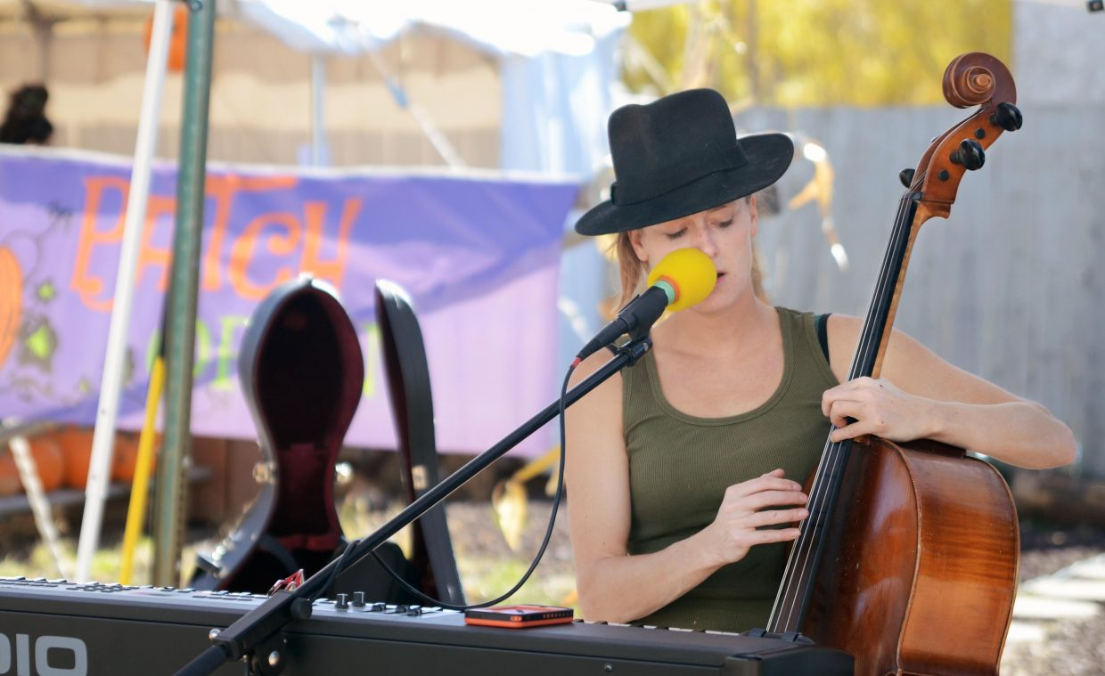 Oak Creek's Callie Bradley performs during the 2014 Oaktoberfest celebration along the town's Main Street on Sunday.