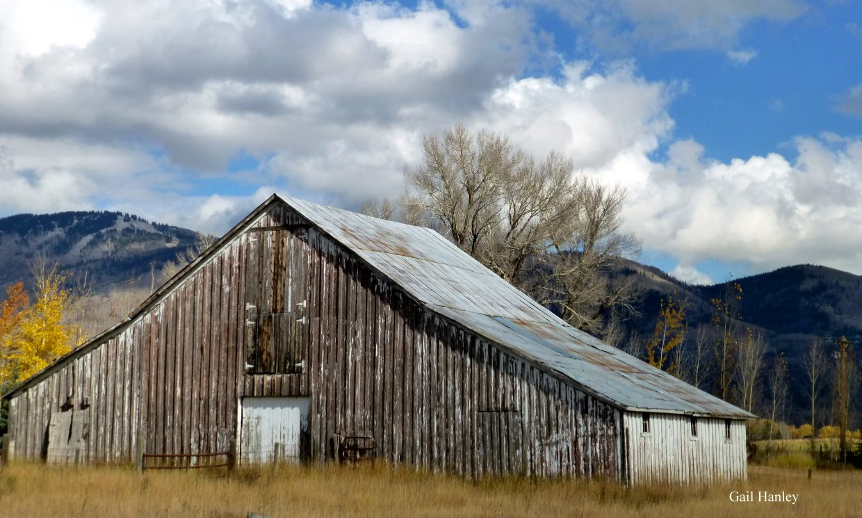 Old barn outside of Steamboat and the ski area in the background. Submitted by: Gail Hanley