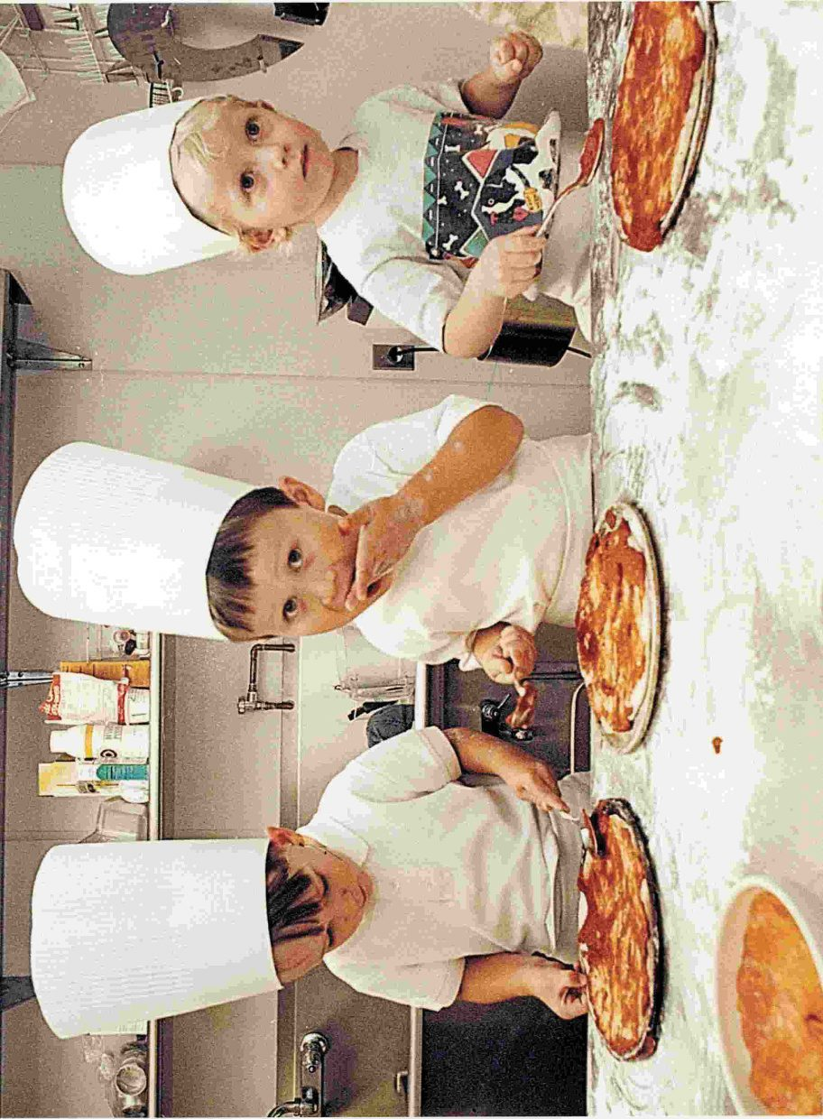 2001 — This photo was taken in 2001 after I got a tip that a local daycare center would be making pizzas at the Steamboat Grand Hotel in Steamboat Springs. I arrived to find chef Connor Frasier, middle, having a taste of sauce. He was joined by classmates Drew Williams, left, and David Cropper, right. The boys will be seniors this year.