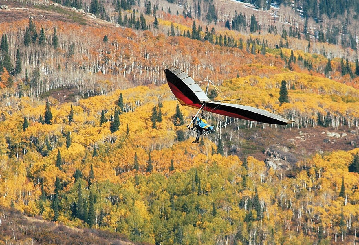 Fall 2001 — I caught this image of a hang glider with bright fall colors behind him in autumn 2001. I saw the hang gliders and hurried to a position that included the fall colors. It's one of those shots that I find just driving around town, and then I have to hope everything falls in place like it did on this day.