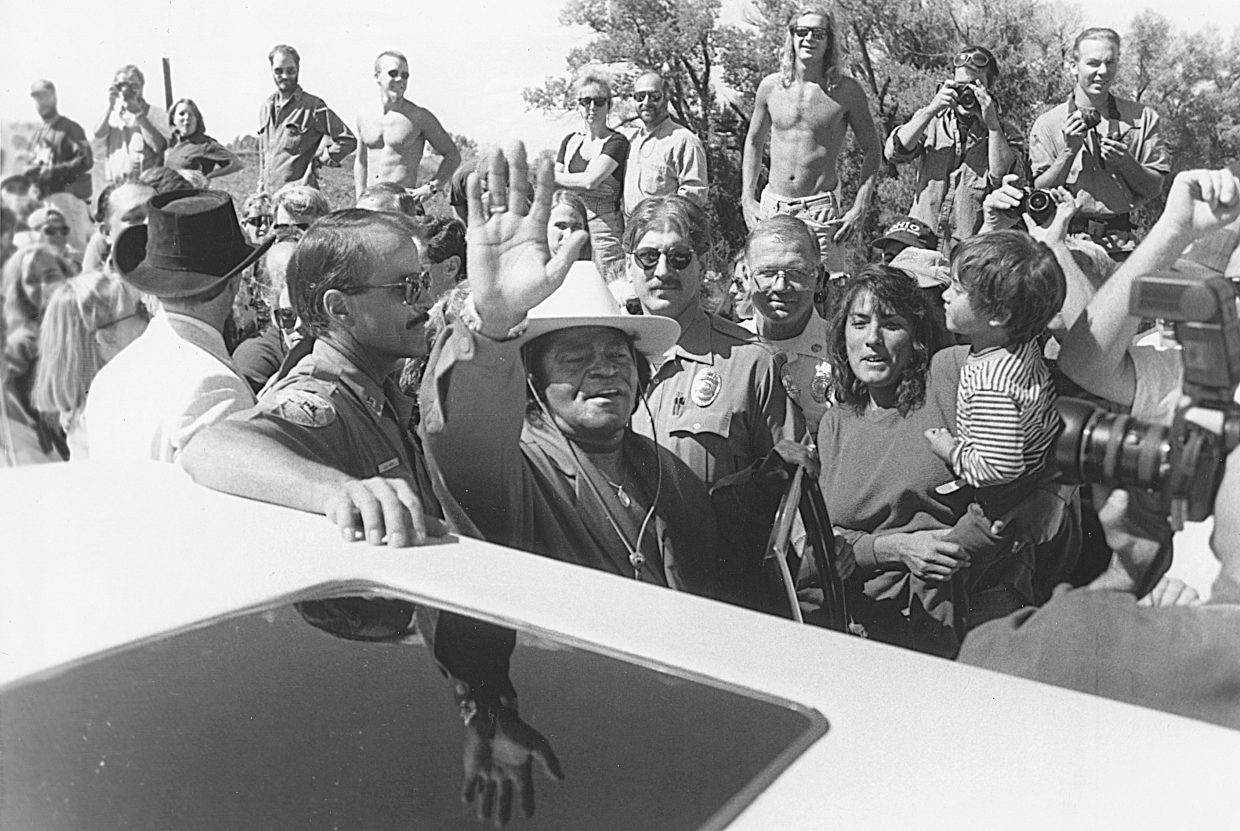 Sept. 1993 — Hundreds of people were crowded on the bridge by the time James Brown rolled up in a white stretch limousines surrounded by police officers there for crowd control. It was Sept. 15, 1993, and the people had shown up for the dedication of the James Brown Soul Center of the Universe Bridge. The moment included a short reading by Steamboat Springs city officials, followed by a few lines from the man himself before Brown climbed back in the car and headed out of town. I had to jockey for position to get a shot of Brown and was thrilled when he decided to pause for a moment and wave to the crowd cheering behind me.