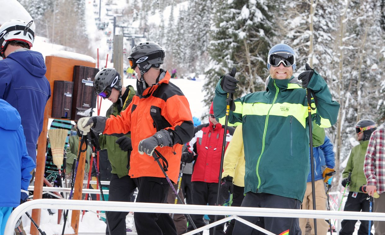 Derek Beers shows some excitement as he gets ready to board a chair at the Storm Peak Express lift Thursday during Steamboat Ski Area's opening day.