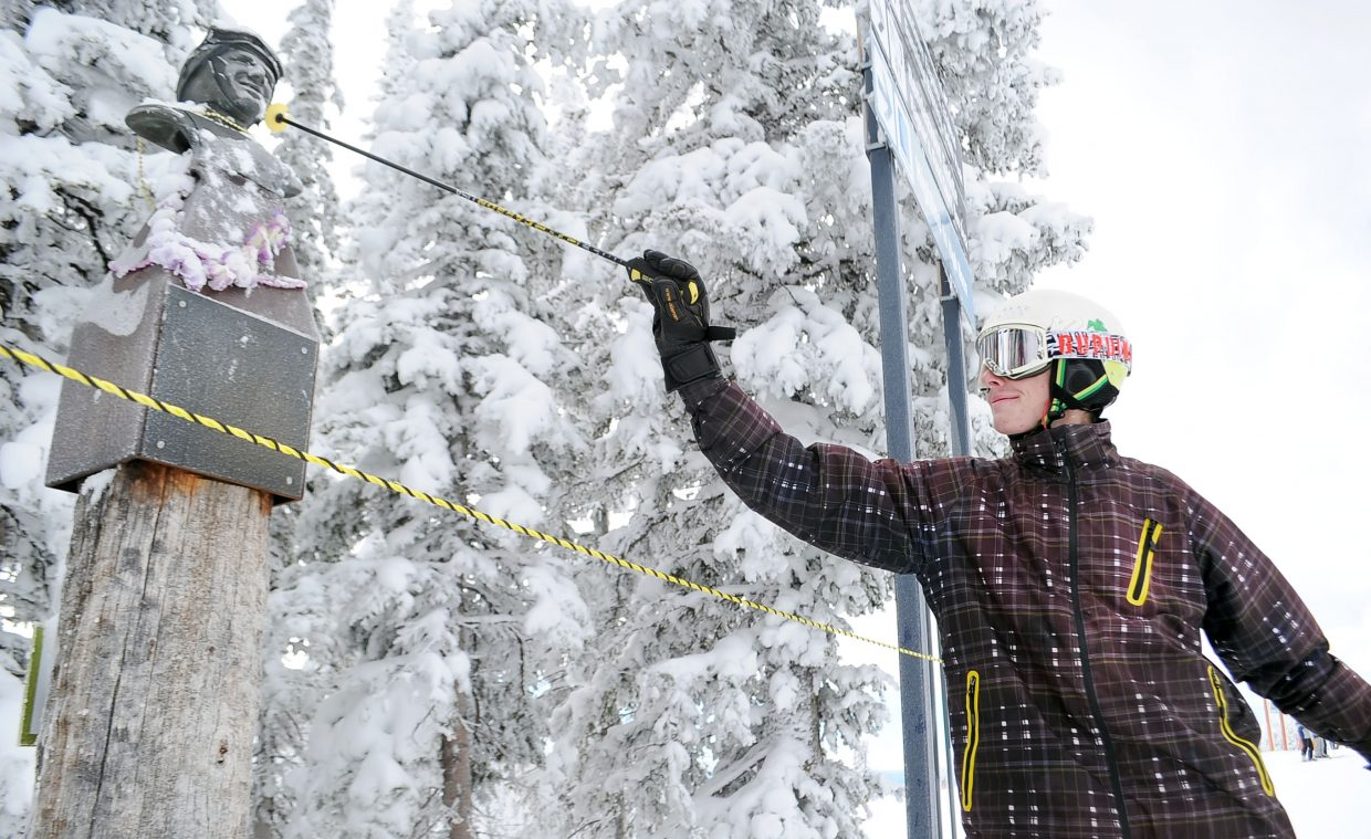 Matthew Pattison, 19, taps Buddy's statue for good luck before heading down Buddy's Run on Thursday during Steamboat Ski Area's opening day, when more than 50 trails were available.