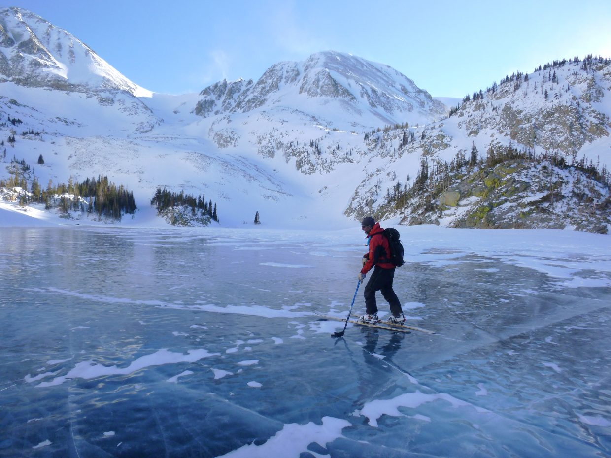Eugene Buchanan ice skates on a high Alpine lake just north of Rocky Mountain National Park during a recent hut trip with family and friends.
