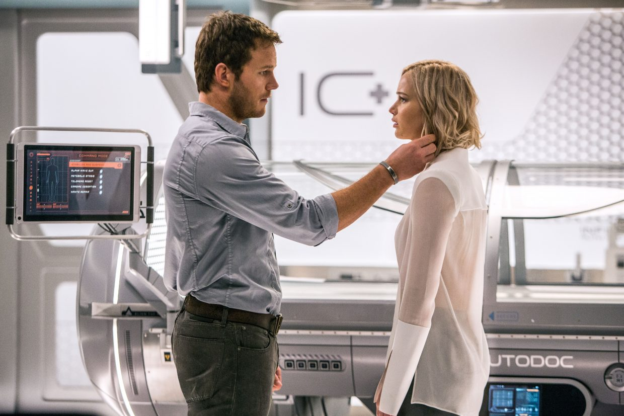 """Jim and Aurora (Chris Pratt, Jennifer Lawrence) must make a difficult decision in """"Passengers."""" The movie is about a spaceship carrying thousands of humans for colonization of a new world, in which two people wake up decades before arrival."""