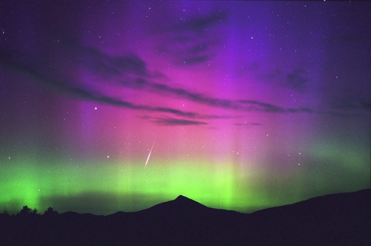 On Aug. 12, 2000, the peak of the annual Perseid meteor shower coincided with a spectacular display of the Northern Lights over Colorado. In this image, a bright Perseid meteor shot through the colorful aurora over the towering silhouette of Hahn's Peak in northern Routt County. This year's Perseid shower is predicted to peak before dawn Friday morning.