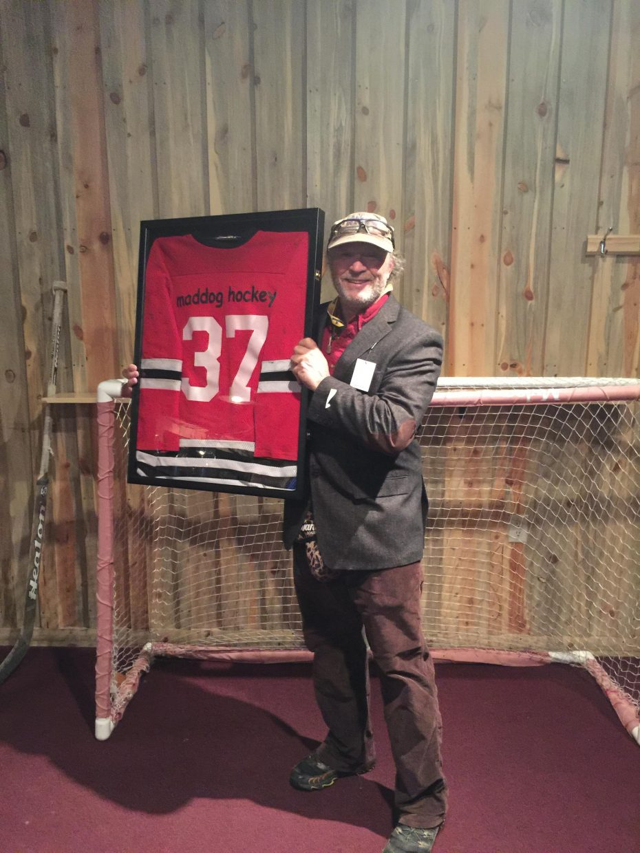"""It might not be of the same caliber as Gordy Howe, Wayne Gretzky or even his net-minding peer Patrick Roy, of the Colorado Avalanche, retiring, but for Backdoor Sports owner Peter Van De Carr, who turns 60 in December, hanging up his goalie skates after 22 years playing for the town league Mad Dogs still was cause for celebration. A surprise retirement party was held by his teammates at McKnight's Irish Pub and Loft on Sunday evening. Here, he poses with his framed No. 37 jersey and a tweed """"coach's"""" jacket before hopping in the net one last time to block """"foam puck"""" shots rifled by his Mad Dog teammates. """"It was a good run,"""" said the cat-like net-minder, whose telltale butterfly won his team seven town championships. """"My ibuprofen bill will now likely be a lot less."""""""