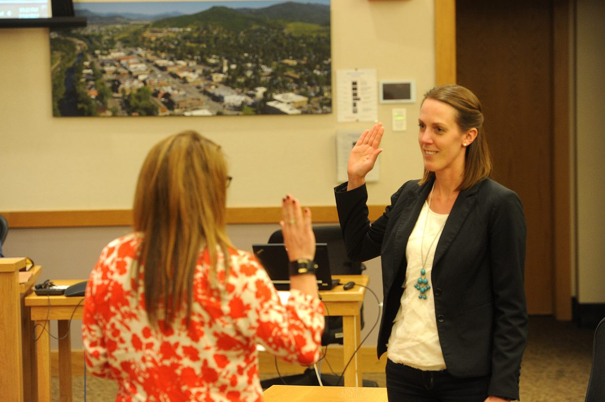 New Steamboat Springs City Council member Lisel Petis takes the oath of office administered by City Clerk Julie Franklin.
