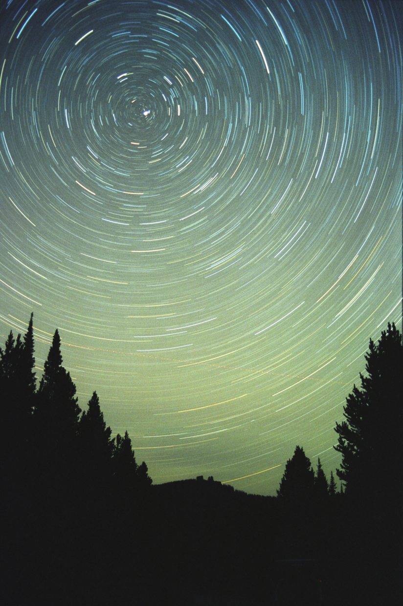 Taking a photograph of polar star trails is as easy as mounting your camera on a tripod and aiming it north for a time exposure. At the center of the concentric star trails will be a single bright star — Polaris, our North Star. This shot, looking north toward Rabbit Ears Peak, was taken in August 2001.