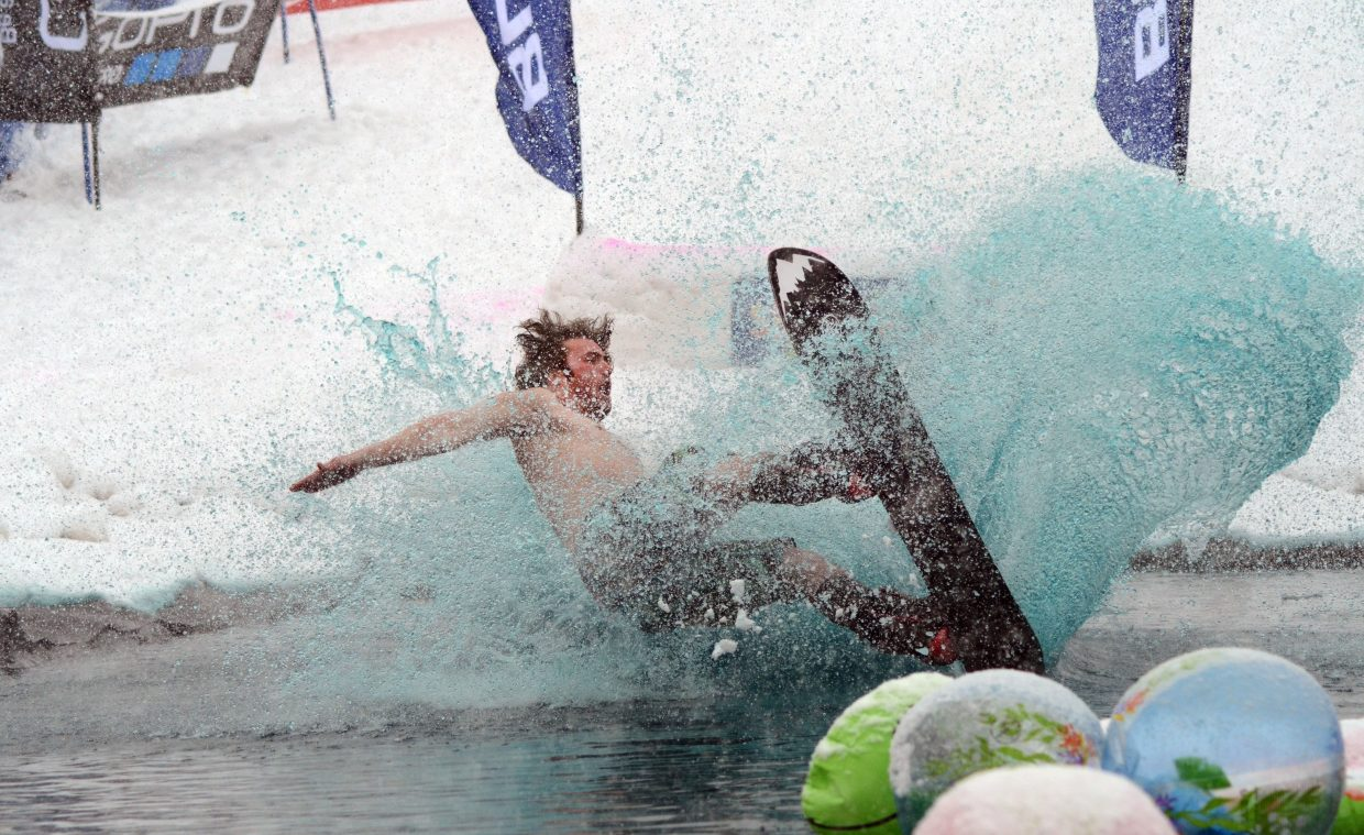 """Logan Ammon was the first snowboarder to take on the Splashdown Pond Skim on Sunday, donning the nickname """"Board Man."""""""