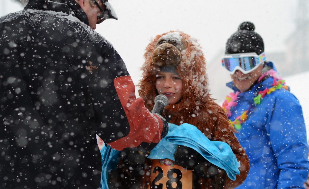 """A shivering Owen Petersen, dressed as """"O-Dawg,"""" does a cold interview after sinking in the 31-degree water at the Splashdown Pond Skim on Sunday."""