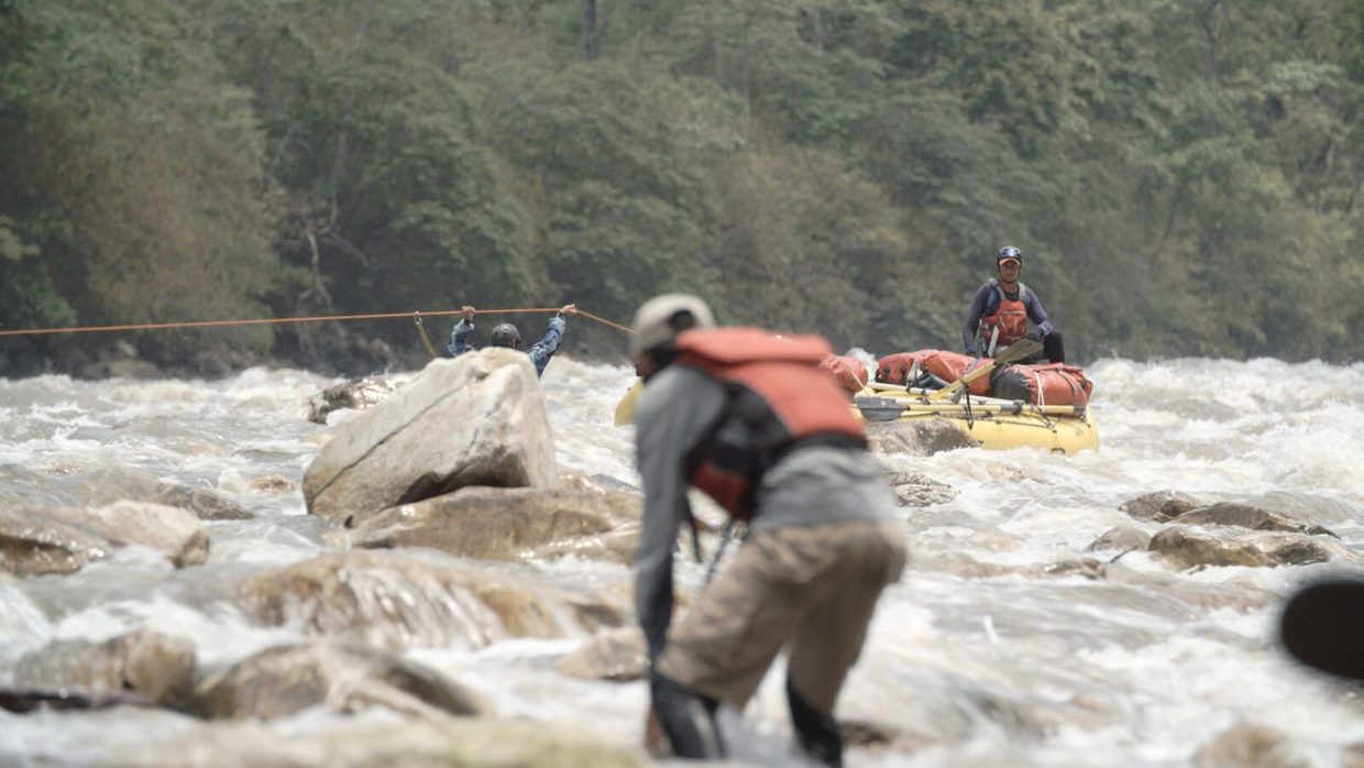 "Crew members rescue a stuck raft on Bhutan's Drangme River during the filming of ""Power of the River."""