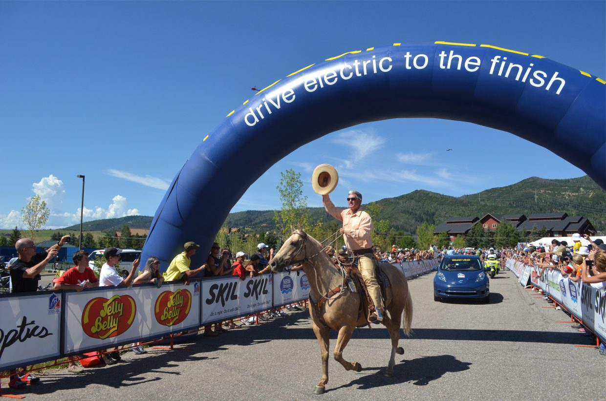 Bob Dapper leads the caravan out of the start on horseback during the USA Pro Cycling Challenge in Steamboat Springs in 2011.