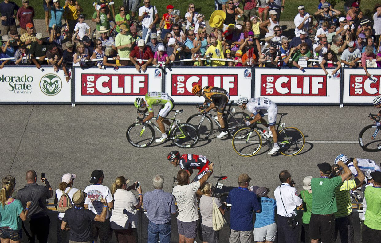 Peter Sagan, in green, pulls ahead to win the sprint at the end of Stage 3 of the 2013 USA Pro Challenge.