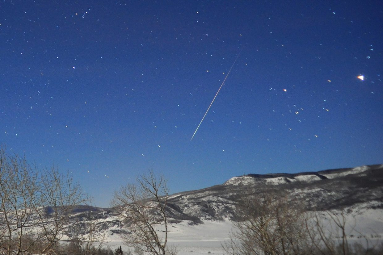 The annual Quadrantid meteor shower is due to peak Sunday after midnight. A single observer might see up to 120 meteors per hour, like the one captured in this image from Jan. 3, 2013. The meteors will stream from a point in the northeastern sky below the handle of the Big Dipper.