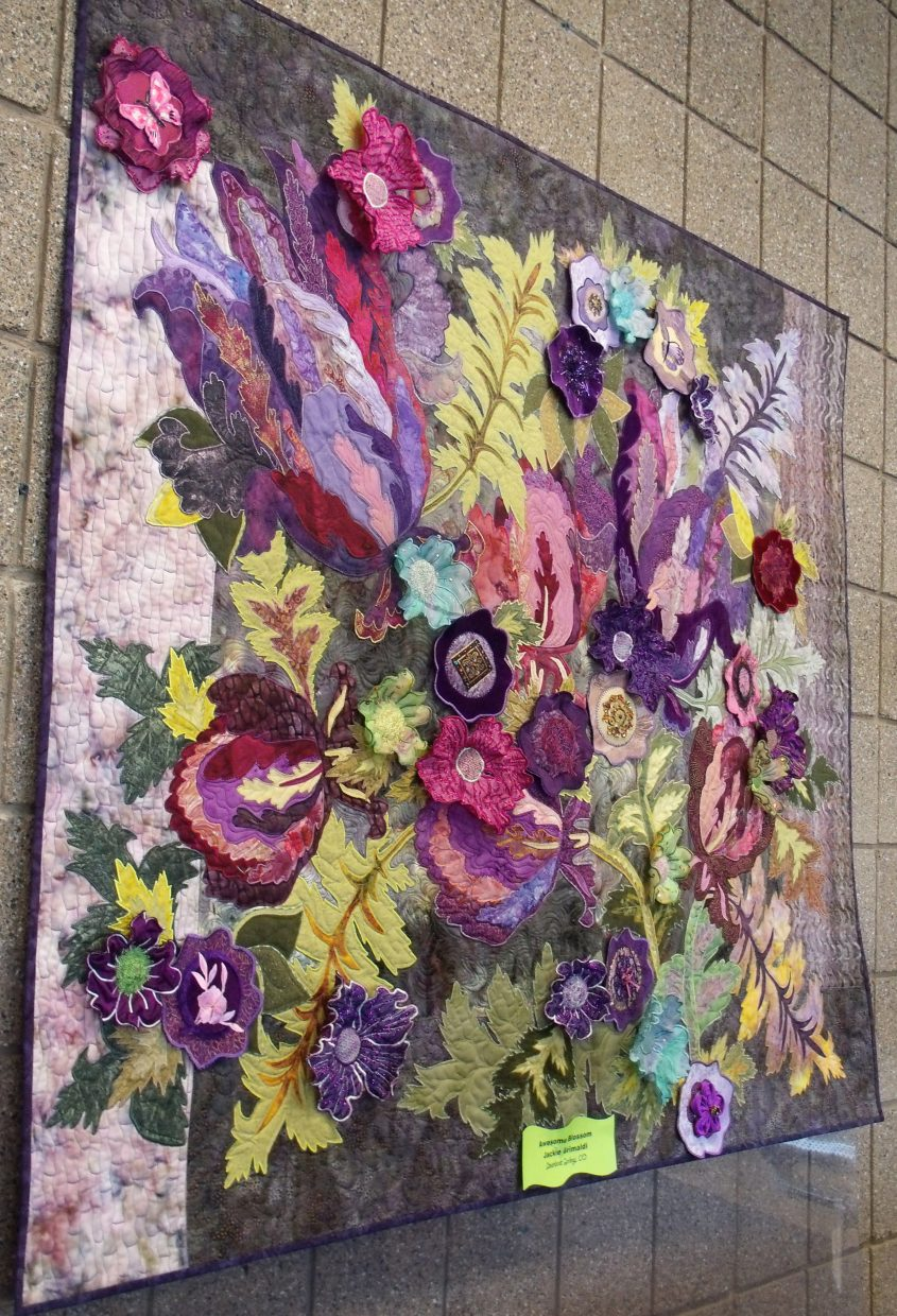 """The quilt """"Awesome Blossom,"""" by Jackie Grimaldi, of Steamboat Springs, was voted the favorite among travelers who viewed an exhibition of 34 locally crafted quilts in the secure waiting areas of Yampa Valley Regional Airport this winter."""
