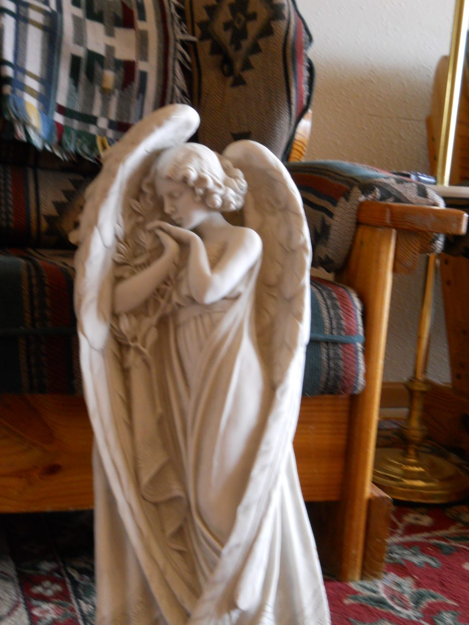 """I am a firm believer in angels on earth! That's my only collection. A nice lady - when she moved in - asked if I wanted this statue in fact for free? It's been in the living room since - but when we move to California - she shall grace our backyard! Hope you see the beauty in her too!"" Submitted by Roxie Pranger."