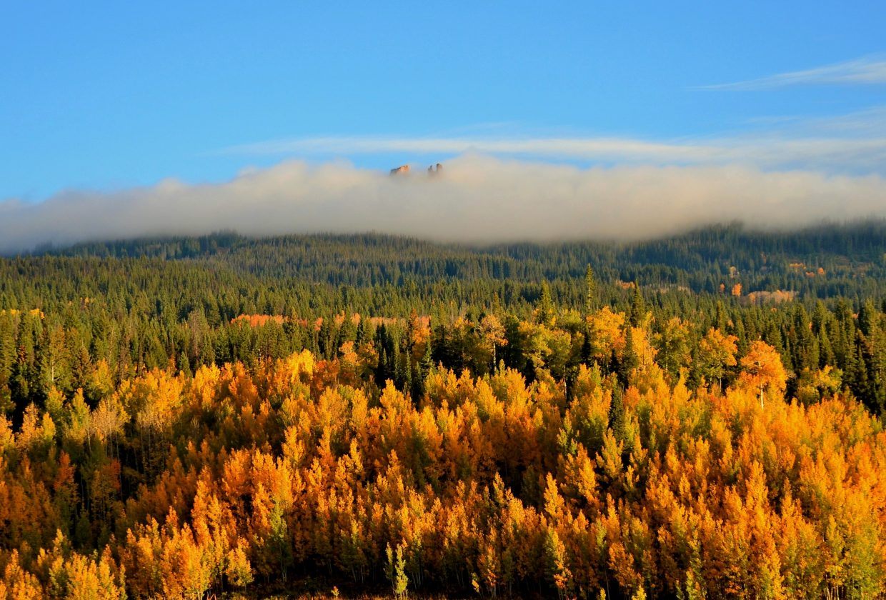 """Here is a picture of the clouds surrounding the """"rabbit ears"""" on Rabbit Ears Pass early Monday morning. Submitted by: Shannon Lukens"""
