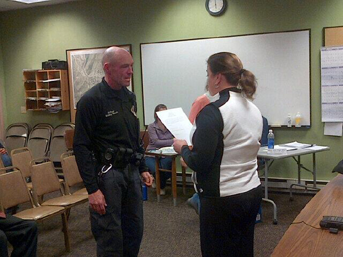 Bobby Rauch is sworn in Dec. 12 as Oak Creek's chief of police. Rauch was hired as an officer for the town in September 2012.