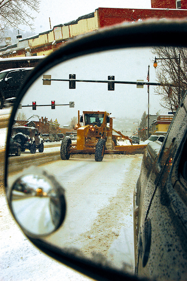 A road grader clears snow from Lincoln Avenue in 2009. The city has returned to a snowplowing system that makes the graders the workhorse of the fleet.