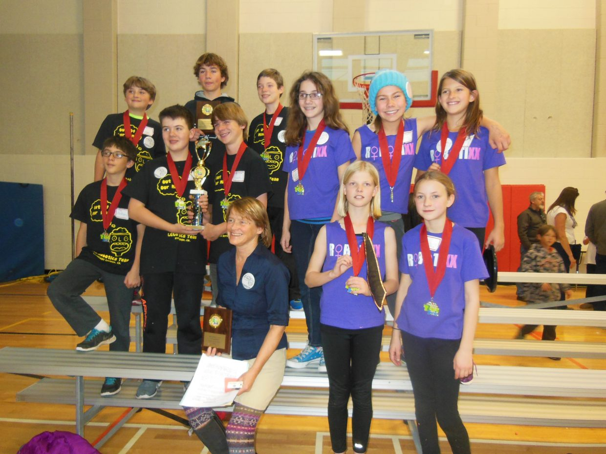 Three Steamboat Springs robotics teams competed in the first Lego League Mountain Regional Tournament Nov. 14 in Aspen, bringing home a trio of impressive awards. Team Out of Our Minds placed first overall in robot design among 20 teams, while team coach Diane Maltby was awarded best coach for the Mountain Regional Division for her work bringing three teams, including two rookie teams, to the tournament. Student mentor Aubrey Morrison was also awarded Best Student Mentor. Pictured above are middle school students from team Out of Our Minds and elementary and middle school students from team Robotixx surrounding Maltby. Not pictured is rookie team Sick Circuits, which also competed.
