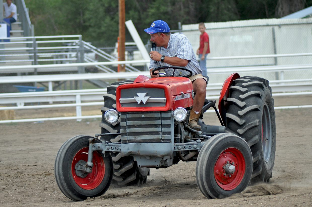 Master of Ceremonies, Rodney McGowen, demonstrates the course in the Blind Tractor Driving event at the 2014 Routt County RedneX Games in Hayden, Colorado. Submitted by: Wendy Lind