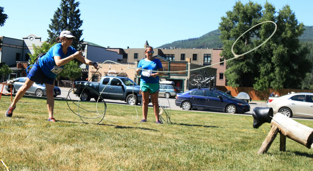 Lena South and Taylor Chamberlin complete the Rope a Steer challenge.