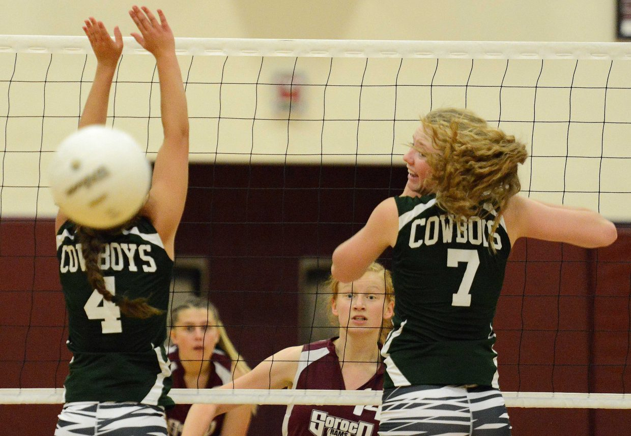Soroco junior Lucy Carlson lays down a kill against Plateau Valley on Saturday. The Rams opened the season 4-0 but suffered their first loss to the visiting Cowboys, 3-0.