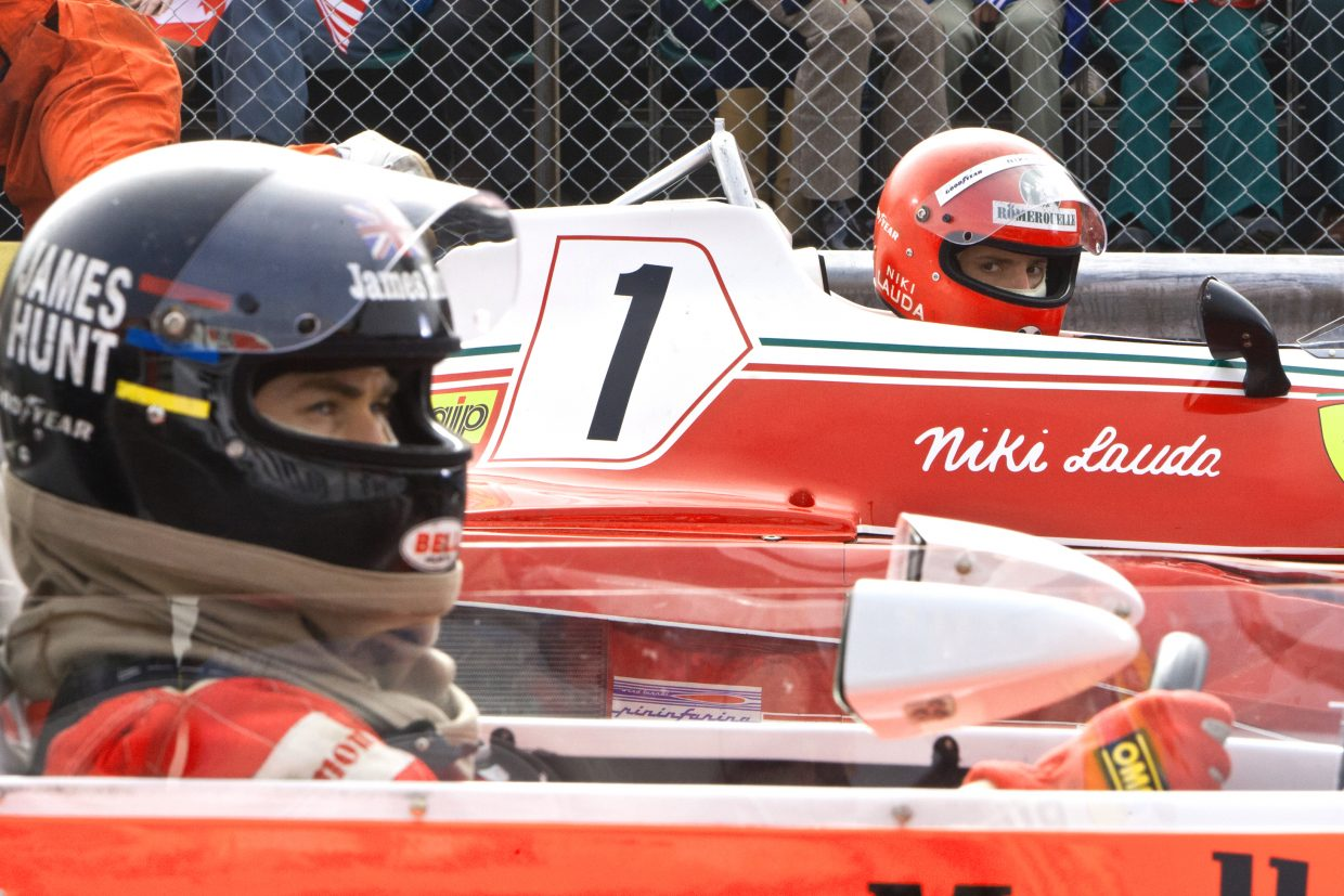 """Racers James Hunt (Chris Hemsworth) and Niki Lauda (Daniel Brühl) await the checkered flag in """"Rush."""" The movie is about the rivalry between the two Formula One drivers in the 1970s."""