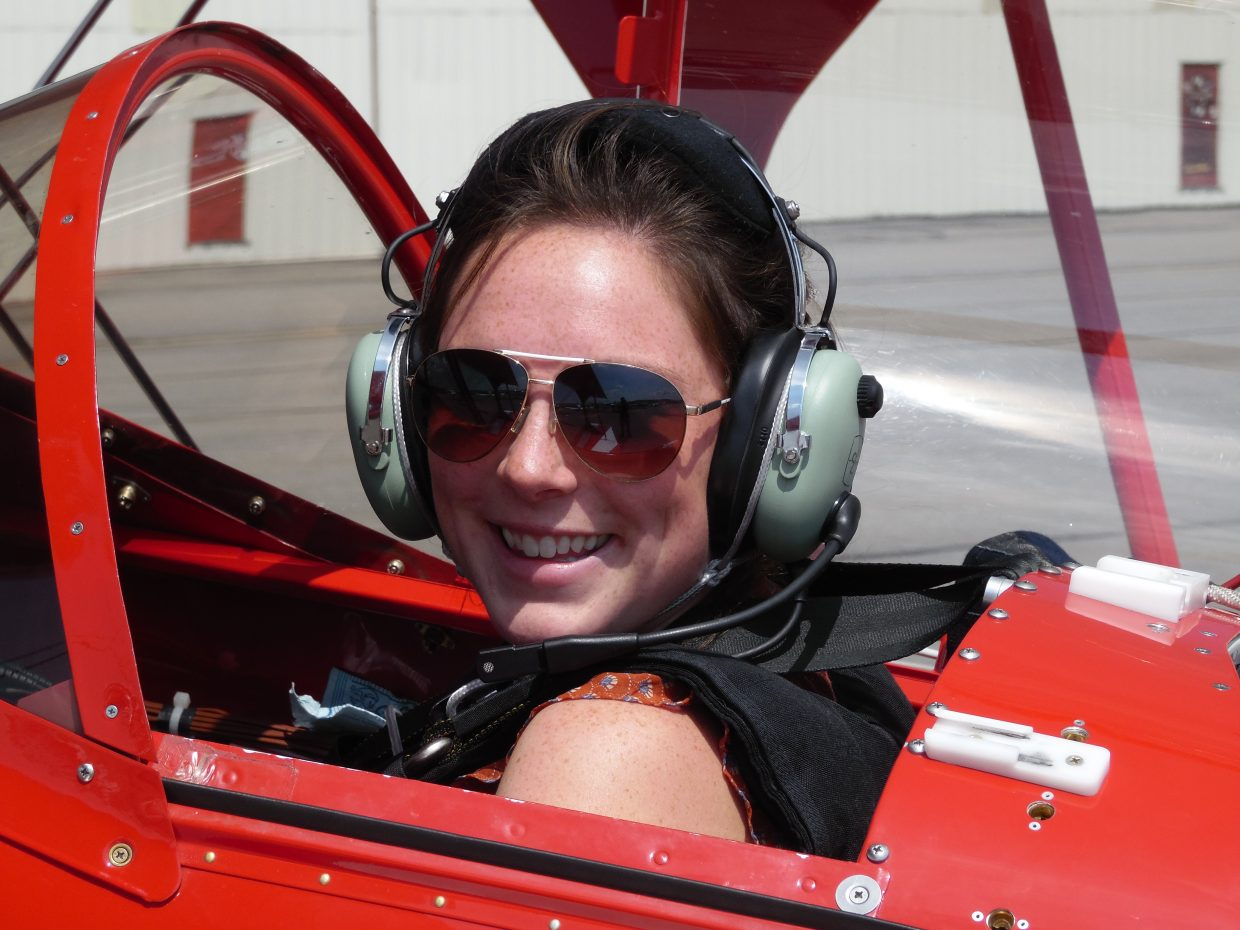 Reporter Audrey Dwyer before she goes up in the sky with Dagmar Kress on Friday afternoon for a practice flight before the Wild West Air Fest tomorrow. Kress will be one of the performers in the show.
