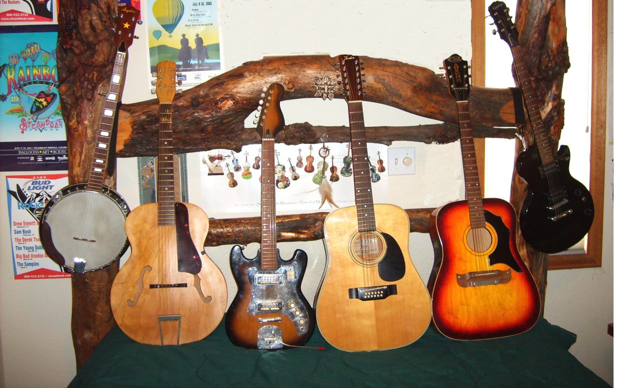 Besides my partner's collection, the real work of art is the hand-made log head board. Makes the music even sweeter. Submitted by Roxie Pranger.