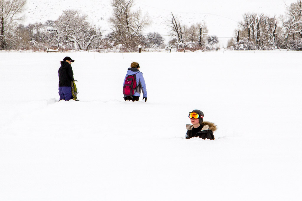 Volunteer Hanna Spence takes a break from working on the community Snow Drawings near Carpenter Ranch.
