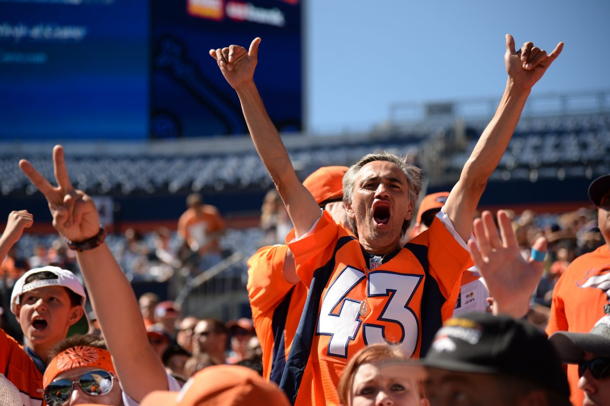Denver Broncos fans welcome the players at Sports Authority Field at Mile High for the Broncos scrimmage Saturday in Denver.