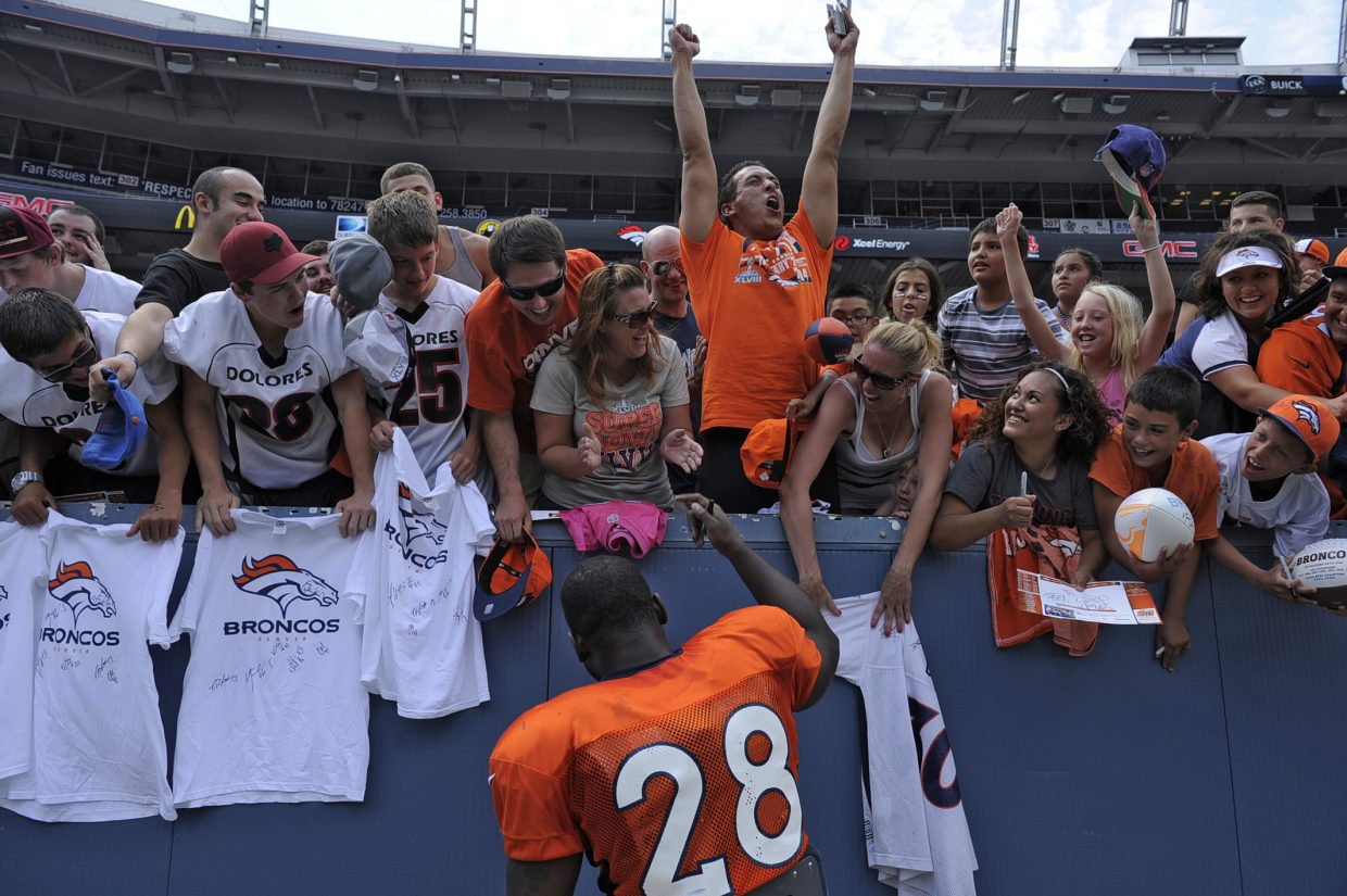 Fans go crazy to have Denver Broncos running back Montee Ball sign autographs after practice on Day 4 of the Denver Broncos 2014 training camp Sunday at Sports Authority Field at Mile High Stadium.