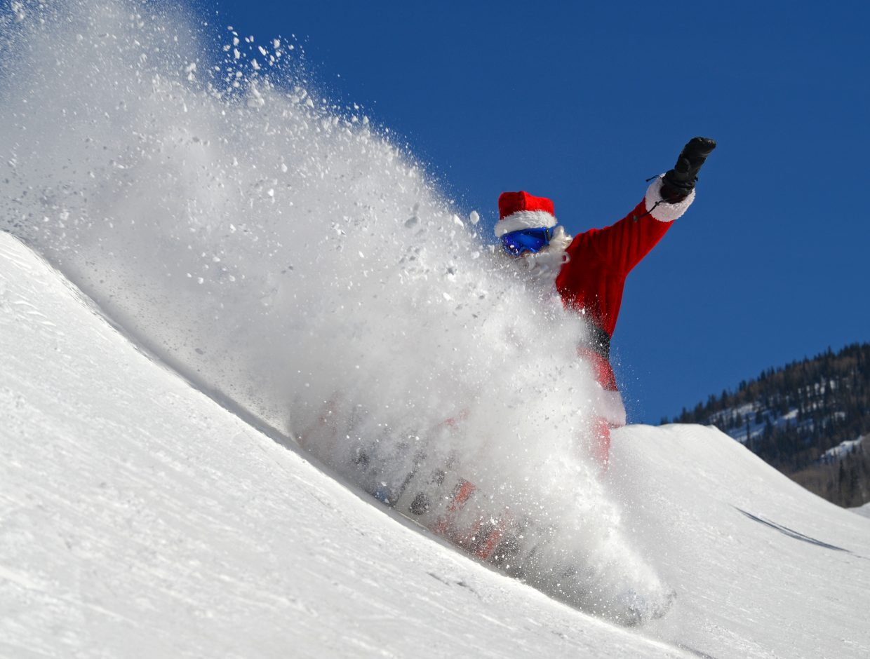 Santa takes a break from delivering presents to hit the half-pipe on Lil' Rodeo and enjoy some of Steamboat Springs' famous Champagne Powder.