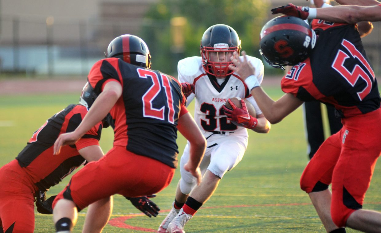 Aspen senior running back Ryan Fitzgerald, No. 32, pounded his way to 33 carries and 343 rushing yards Friday night as the Skiers beat Steamboat, 23-14.